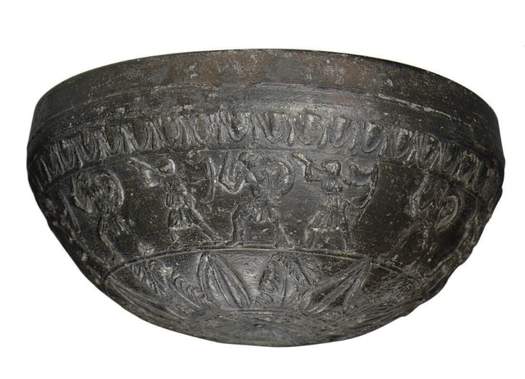 A MEGARIAN WARE POTTERY BOWL   HELLENISTIC PERIOD, CIRCA 2ND CENTURY B.C.   Mold-made & black-glazed, the base centered by a rosette surrounded by a disk, from which radiates a composite floral of six acanthus petals folded at the tip, alternating with two types of acanthus petals, with an Amazonomachy frieze above of seven warriors with circular shields & short swords, alternating with seven Amazons carrying shields & spears, a band of egg-and-dart below the rim  5¼ in. (13.5 cm.) diameter