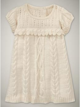 Cream baby girl sweater dress - perfect when paired with those gold Joy Folie shoes, or that stripped pair with the orange blooms, reminiscent of an Anthropologie product.