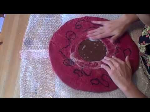 www.feltinglessons.com has ALL these felting videos, plus photo gallery, printable instructions, links to resources and project ideas!    This video shows how to felt around a resist.  Wet felting with a template to make a beret as an example.