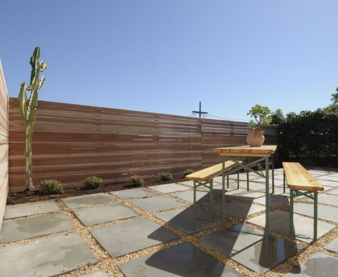 Splashy Wood Fences  mode Los Angeles Midcentury Patio Innovative Designs with  bench table centerpiece gravel outdoor dining pavers plants shrubs trees wood fence