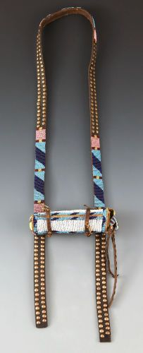 American Indian Art:Beadwork and Quillwork, A BLACKFEET BEADED BUFFALO HIDE TELESCOPE CASE WITH TELESCOPE. c.1870... (Total: 2 Items)