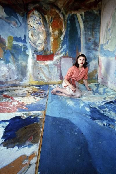 Painter Helen Frankenthaler sitting amidst her art.