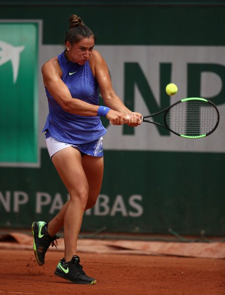 Sara Sorribes Tormo Photos Photos - Sara Sorribes Tormo of Spain plays a backhand during the ladies singles first round match against Timea Bacsinszky of Switzerland on day one of the 2017 French Open at Roland Garros on May 28, 2017 in Paris, France. - 2017 French Open - Day One