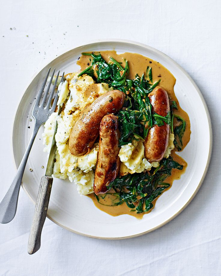 We've taken bangers and mash to a whole new level by adding garlic and capers to the mashed potatoes and then drenching it all in a creamy spinach sauce.