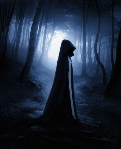 A cloaked figure stands in front of the woods. Hauntingly ...
