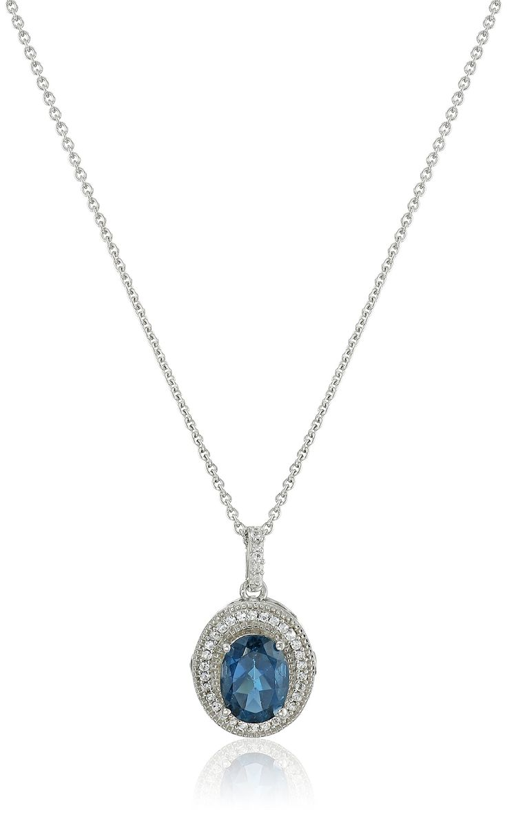"Sterling Silver Oval London Blue Topaz with Round Created White Sapphire Pendant Necklace, 18"". Imported."