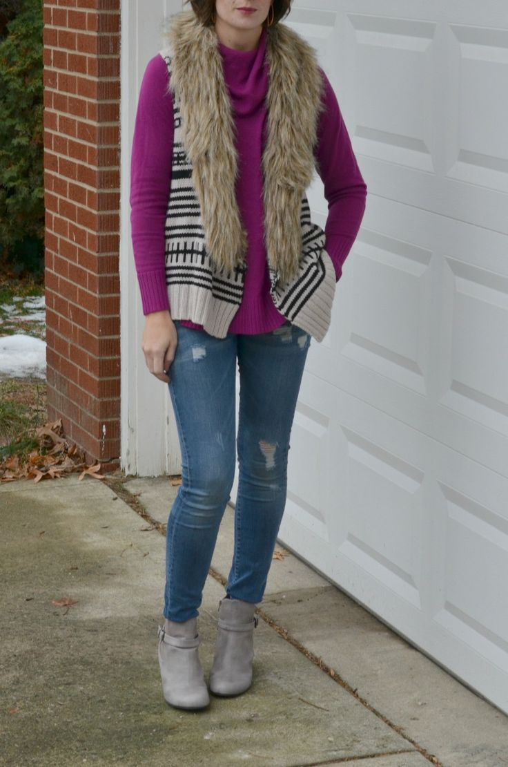 layering up for winter women's fashion with a purple cowl neck sweater, fur trimmed sweater vest, distressed skinny jeans and stone colored ankle wedge booties