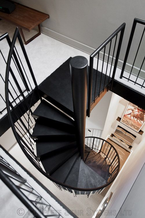 Small spiral staircase with jet black wooden treads