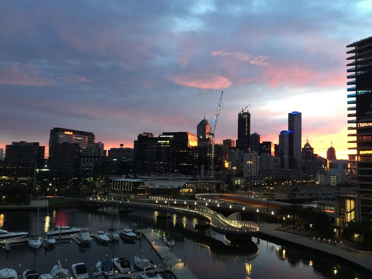Sun rise over looking Melbourne cbd from the docklands on a lovely autumn morning .