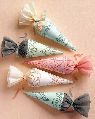 Gift wrap idea. If you needed favours for a kids party, you could use inexpensive party hats and some sheer material or cello bags inserted into the cones so they can see their goodies. Remove elastic band and replace with ribbon as a holder. I think the kids would love it!