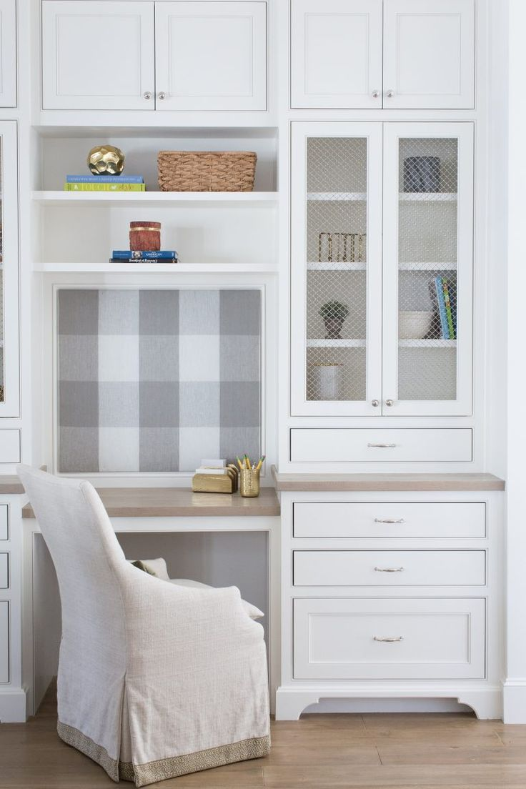 Office space in laundry room.  Office nook with push pin board and built in shelving