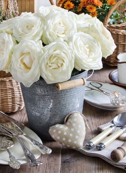 50 Inspiring Centrepieces; fill zinc buckets with oversized silk roses