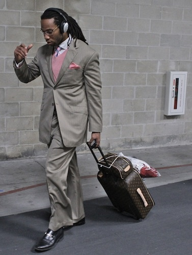 Larry Fitzgerald knows how to rock a pink tie. #NFL