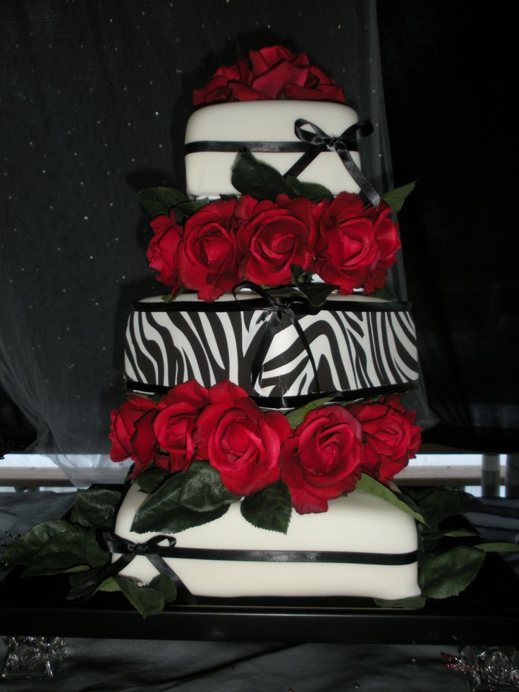 Red, White, and Zebra wedding cake - 3 tier white and zebra cake with red roses - Sept 2011