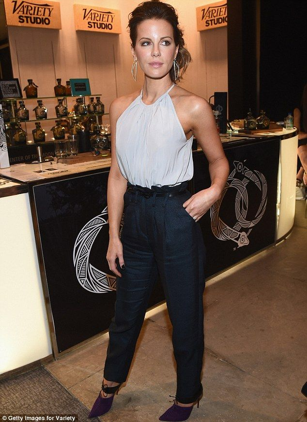 Also appearing: British actress Kate Bekinsale went casual chic at the Variety Studio as she donned a grey halter top tucked into black trousers and dark purple heels