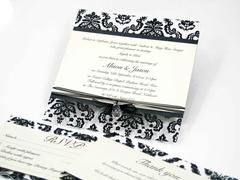"The ""Acetate Damask"" is a unique wedding invitation design and is constructed with a layer of damask acetate exclusive to Inspired Design and is layered with Onyx and Quartz paper with a scripted text of your choice. This invitation is then finished off with a thin organza ribbon and charm of your choice  This wonderful invitation can be printed on a selected range of cards and modified to suite your color theme or individual events"