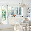 Cottage-Style Open Kitchen  Don't care for the white, but love the windows and door..