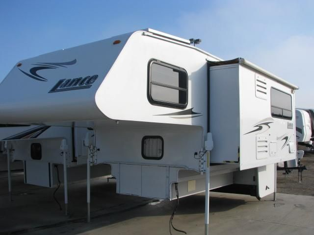 2008 Used Lance 1181 Truck Camper in California CA.Recreational Vehicle, rv, 2008 Lance 1181 877-485-0190 CALL DAVID MORSE 4 BEST PRICE 877-485-0190 CALL DAVID MORSE 4 BEST PRICE,4 SOLAR PANELS,ONAN GENERATOR,AIRCONDITIONING,2 AWNINGS WITH AWNING TOPPER,POWER INVERTER,ROOF LADDER,2 FLATSCREEN TVS,DVD,AMFMCD,CUSTOM INTERIOR,DINETTE AND REFRIG SLIDEOUT,REMOTE LEVEING JACKS,FANTASTIC FAN,MICROWAVE,LOADED.