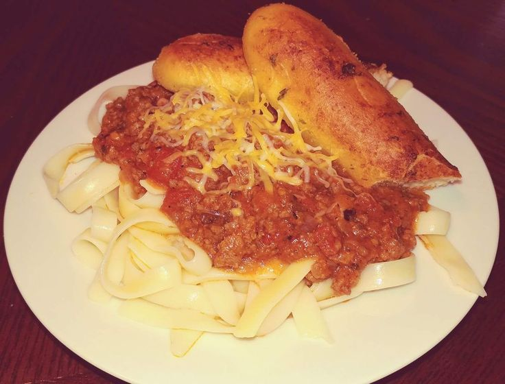 FETTUCCINI with Homemade Spaghetti Sauce  1 - 16 oz. package of FETTUCCINI, cooked according to the directions on the package.  1 Medium Onion, finely chopped2  3(14.5oz.) Cans of ...