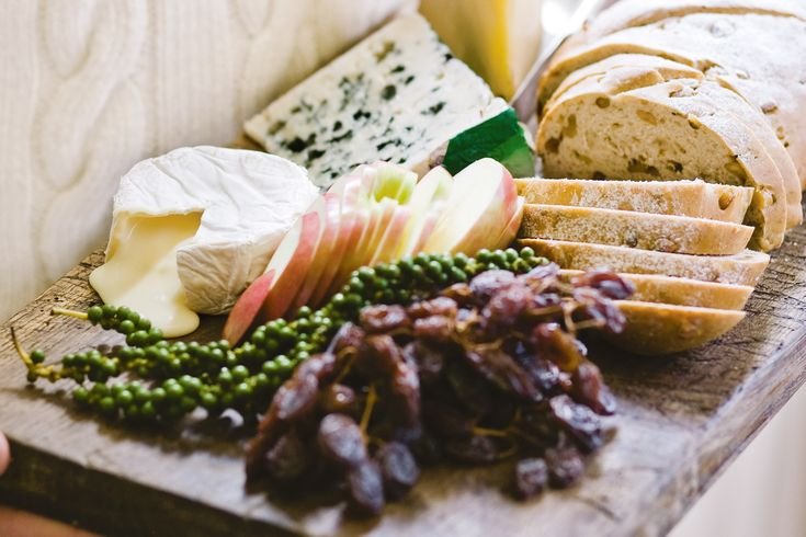Create+a+gourmet+cheese+platter+with+beautiful+assorted+cheeses+and+home-made+walnut+bread.