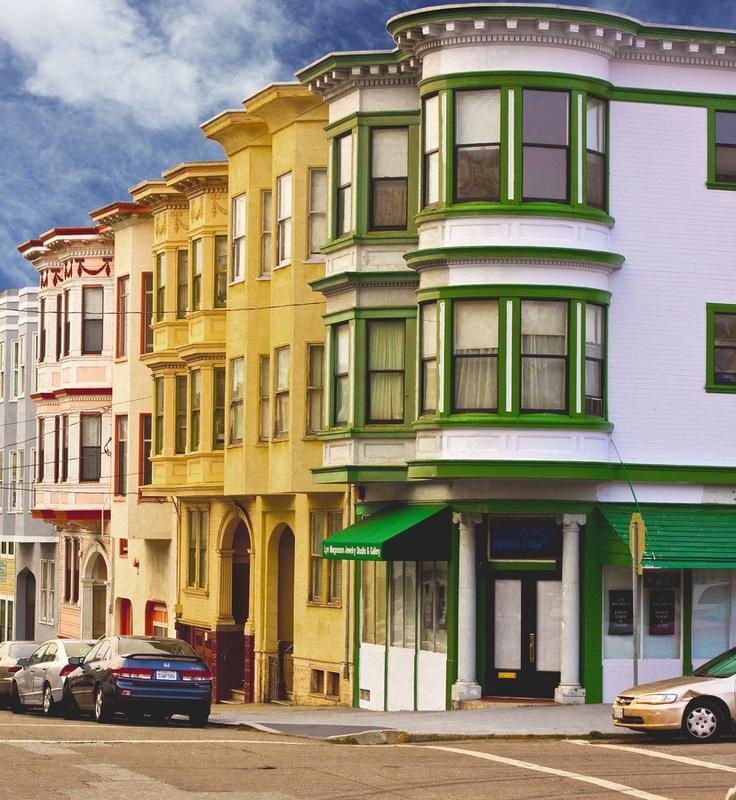 A row of colorful apartment buildings near Columbus Avenue in San Francisco, California
