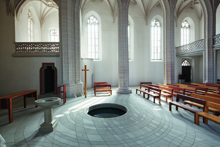 Baptismal font at Church of St. Peter and St. Paul in Eisleben, Germany - the site of Martin Luther's baptism.