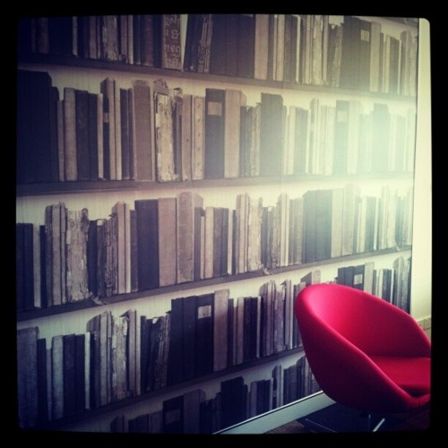 "The ""Chill Out Space"" at the Australia Red Cross Employment Services office in Fortitude Valley.  I want this wall paper!    #Books #Wallpaper #Library #Noir"