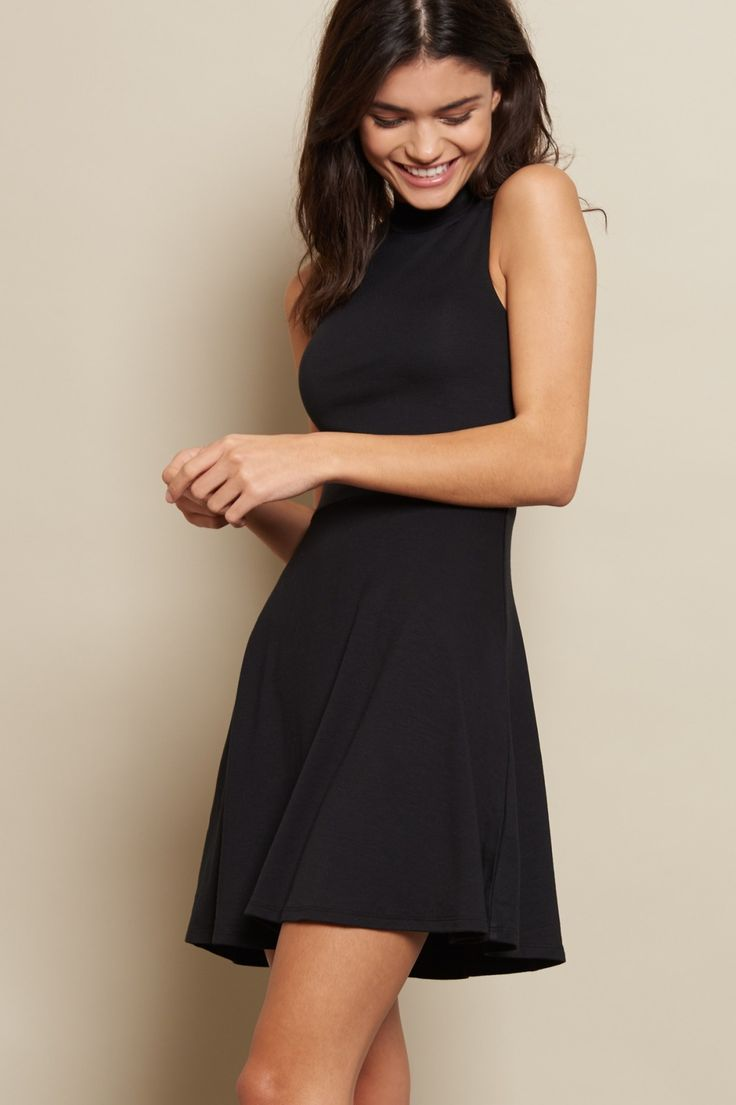 Featuring a mockneck and a flirty back cutout, this fit & flare dress is a must-have!