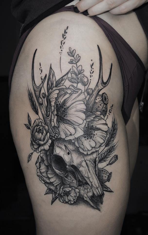 Deer skull with flowers by Kati Berinkey.