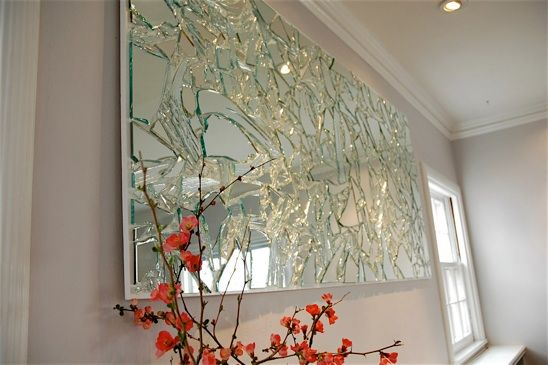 Broken Mirror Art from recycled mirror bits and pieces. When the light hits it, the whole room shimmers!