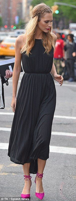 Here we go: The statuesque model opted to go braless for her appearance at a SoHo party thrown for accessory designer Eddie Borgo, but looked classy in a sleeveless black dress with a pleated detail and cinched waist that drew attention to her slender physique