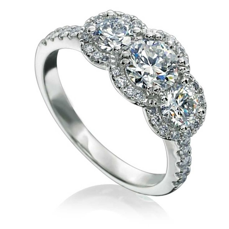 Vintage inspired halo ring with round brilliant diamonds perfectly frames 3 Forevermark diamonds.
