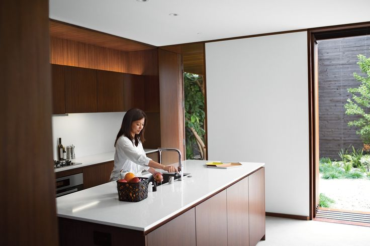"""""""I love the house more each day,"""" says Tamami Sylvester of her and husband Michael's home by Sebastian Mariscal in Venice, California. The kitchen, which includes all Miele appliances, is sheathed in custom woodwork from Semihandmade. Accessories from A+R complement the Caesarstone countertops and Franke faucet. A LifeSource Water System provides filtration. Photo by Coral von Zumwalt."""