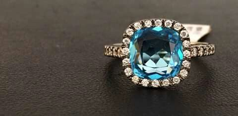 18 carat black rodium ring with diamonds and blue topaz