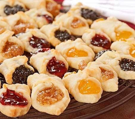 Ingredients 1 (8 ounce) package cream ceese, softened 1 cup butter 1/2 cup confectioners' sugar 2 cups all-purpose flour 1 (12.5 ounce) can apricot fruit filling (such as Solo(R)) 1/4 cup confectioners' sugar for dusting Directions Place the cream cheese and butter in