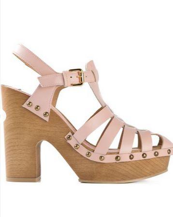 Meet this summer's normcore sandal: the versatile and comfy clog. Shop this season's 11 best takes, including L'Autre Chose buckle clog sandals.