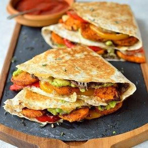 Loaded veggie quesadillas - delicious, filling, healthy quesadillas stuffed with spiced roasted sweet potato, peppers, black beans, avocado, cream cheese and cheddar.