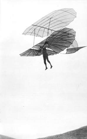 German inventor Otto Lilienthal riding a bi-plane glider with bird-like wings ca. 1985.