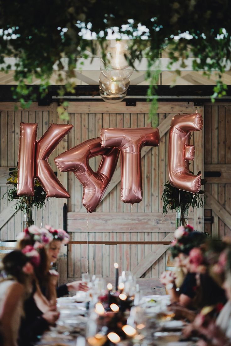 giant rose gold letter balloons for a stylish hen's day