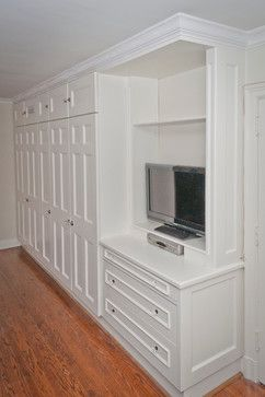 Built In Closet Design...Perfect! This looks just like the space our bedroom has