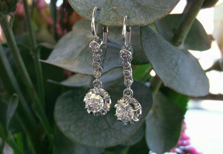 A gorgeous addition to any wardrobe! From the 1920's, a pair of Old European cut diamond earrings with 1.00 carats total weight in diamonds set in white gold.
