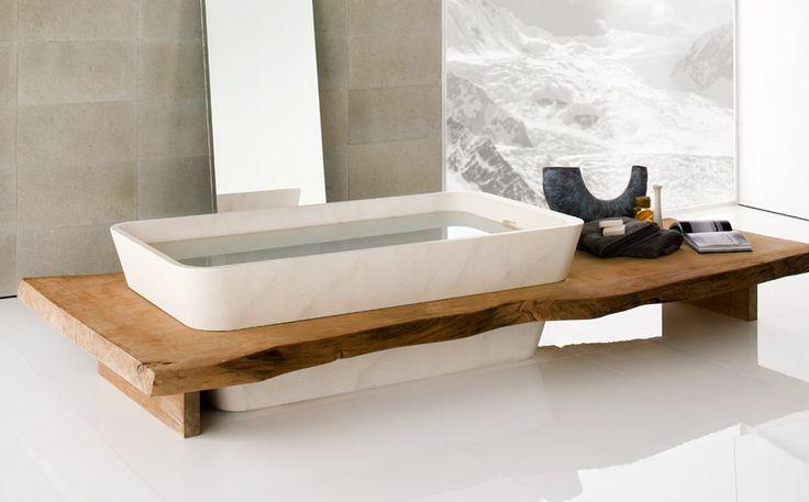 NEUTRA BATHTUB DUO in natural stone with Kauri wood board: #madeinitaly, #stone, #naturalstone, #interior, #architecturedesign, #interiordesign, #forniture,  #bathroom, #bathtubs,  #hydrobathtubs, #Bathroomcollection, #Kauriwood, #wood,