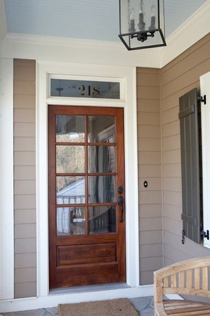 Country Front Door with Transom window, exterior stone floors, Glass panel door