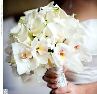 Bouquet: cymbidium orchids, mini calla lillies, stephanotis