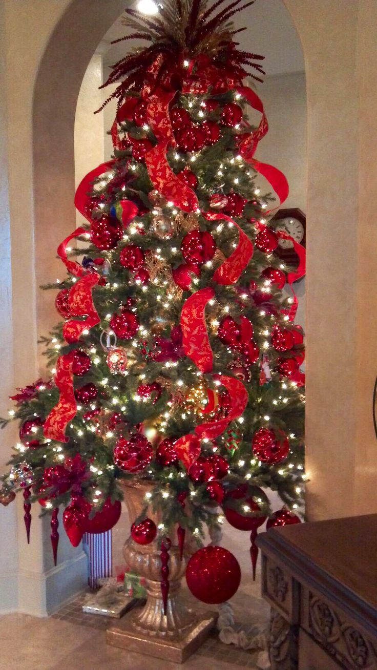 """Designed by Rick Butler/ Garden District. """"I like a real loose loop in my trees. This tree was a full 7 1/2. I made it look giagantic because the ribbon fools the eye in big loops. Only works with wired ribbon."""""""