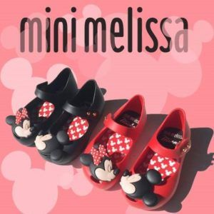 Mini Melissa Shoes - These adorable Disney Mini Melissa shoes are a peep toe flat that comes in either black or red with Mickey/Minnie embellishment on top of them. These shoes are perfect for any Disney lover and who does not love Disney?