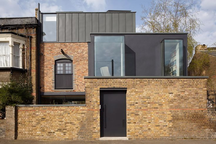 Giles Pike Architects chose concrete and galvanised steel for the renovation and extension of this east London house, referencing the brick building's industrial heritage