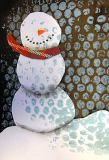 pastel shading on snow and background, collage paper and fabric, bubble wrap printed tint of blue for snow