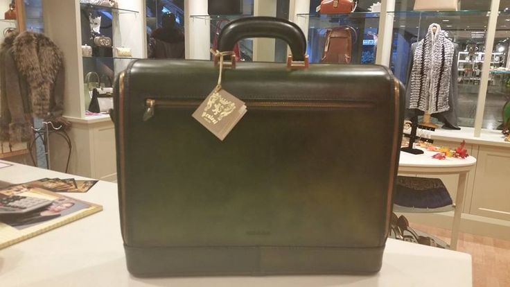 Great unique Pratesi unisex briefcase just in for $475. Inside opens up for easy travel and also makes a great writing surface for business on the go.