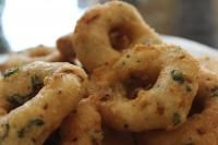Medu Vada recipe.  1 cup Urad dal1 green chilli green chillies 3 large onion, finely chopped2 tbsp curry leaves, finely chopped½  tsp roasted jeera, crushed¼ tsp black pepper, crushed2 tbsp fresh coriander leaves, choppedSalt to tasteWater  as neededA pinch hing